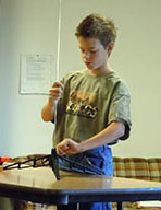 4-H boy working on rocketry project